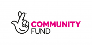"Community fund logo says ""Community Fund"" with the crossed fingers in pink and black."